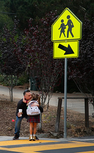 Simone Garcia-Afshar gets a hug from her father, Ramon Garcia, on the first day of school at the re-opened Hoover Elementary school in Burlingame, Calif., Wednesday morning, Aug. 24, 2016. The school had been shuttered for years. (Karl Mondon/Bay Area News Group)