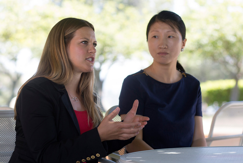 """. Kristen Beck, left, and Kun \""""Maggie\"""" Hu discuss their work at IBM Almaden Labs in San Jose, Calif., Wednesday, Aug. 3, 2016.  IBM Almaden Labs will celebrate its 30th anniversary on August 11.  (Patrick Tehan/Bay Area News Group)"""