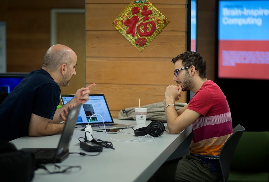 . Engineers Eduardo Coria, left, and Jordi Montes discuss a problem at IBM Almaden Labs in San Jose, Calif., Wednesday, Aug. 3, 2016.  IBM Almaden Labs will celebrate its 30th anniversary on August 11.  (Patrick Tehan/Bay Area News Group)