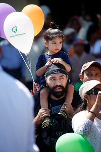 Manjot Walia, 2, watches the India Day parade from the shoulders of her father Manpreet Walia along Paseo Padre Parkway Sunday, Aug. 14, 2016, in Fremont, Calif. (Karl Mondon/Bay Area News Group)