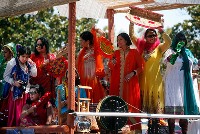 Woman in colorful clothing ride aboard the the Haryanvi Bay Area Association float during the India Day parade Sunday, Aug. 14, 2016, on Paseo Padre Parkway in Fremont, Calif. (Karl Mondon/Bay Area News Group)