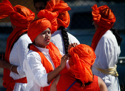 Members of the Marathi Community float prepare their colorful scarves before the start of the India Day parade Sunday, Aug. 14, 2016, in Fremont, Calif. (Karl Mondon/Bay Area News Group)