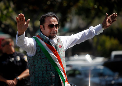 Bollywood actor Gulshan Grover waves to the crowd during the India Day parade Sunday, Aug. 14, 2016, in Fremont, Calif. (Karl Mondon/Bay Area News Group)