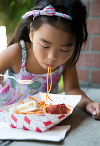 Madison Matsui, 6, eats spaghetti at the Italian Family Festa, at History Park inside Kelley Park, in San Jose, Calif., on Saturday, August 27, 2016. (LiPo Ching/Bay Area News Group)