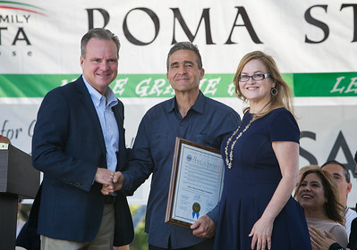 At center, Italian American Heritage Foundation President David Perzinski receives a commendation from Santa Clara County Supervisors Dave Cortese, left, and Cindy Chavez, right, at the Italian Family Festa, at History Park inside Kelley Park, in San Jose, Calif., on Saturday, August 27, 2016. (LiPo Ching/Bay Area News Group)