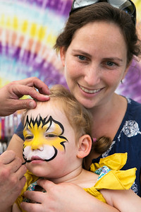 Helen Solnit, holds her daughter Talia Solnit, 2, as Talia gets her face painted at the Italian Family Festa, at History Park inside Kelley Park, in San Jose, Calif., on Saturday, August 27, 2016. (LiPo Ching/Bay Area News Group)