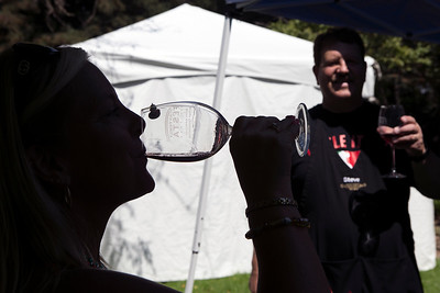 Pam Junette of Gianelli Vineyards tastes some wine after checking the pour from the Guglielmo Winery at the Italian Family Festa, at History Park inside Kelley Park, in San Jose, Calif., on Saturday, August 27, 2016. (LiPo Ching/Bay Area News Group)