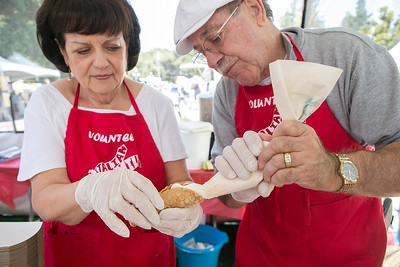 Italian American Heritage Foundation volunteers from right, Larry Lohman and Kathy Lohman make cannolis at the Italian Family Festa, at History Park inside Kelley Park, in San Jose, Calif., on Saturday, August 27, 2016. (LiPo Ching/Bay Area News Group)