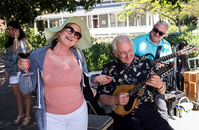 From left, Rose Cortez dances as Al Fabrizio and Hugo Wainzinger of Hearts Strings Music play the mandolin and guitar at the Italian Family Festa, at History Park inside Kelley Park, in San Jose, Calif., on Saturday, August 27, 2016. (LiPo Ching/Bay Area News Group)