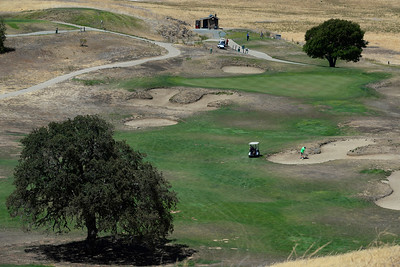A golfer hits out of the bunker on the 9th hole at Roddy Ranch Golf Club in Antioch, Calif., on Monday, Aug. 8, 2016. The golf course will be closing after Aug. 11th. (Jose Carlos Fajardo/Bay Area News Group)