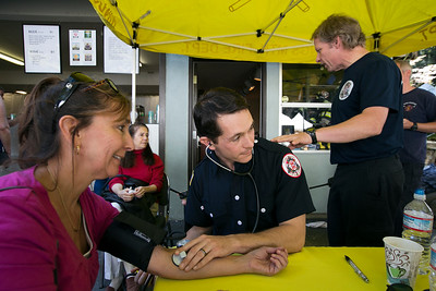 At center, Kings Mountain Firefighter Andrew Dillinger takes the blood pressure of Monica Karate of Los Altos during the King's Mountain Art Fair at the King's Mountain Firehouse in Woodside, Calif., on Monday, September 5, 2016. (LiPo Ching/Bay Area News Group)