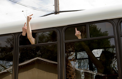 Unidentified people who entered a shuttle outside of Life Choices, a residential drug rehabilitation facility, gesture as they leave the facility in San Jose, Calif., on Wednesday, Mar. 5, 2014.   (LiPo Ching/Bay Area News Group)
