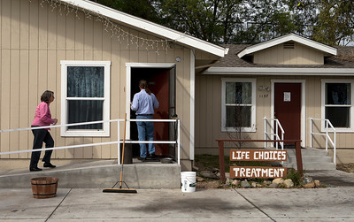 Unidentified people enter the main office of the Life Choices residential drug rehabilitation facility in San Jose, Calif., on Wednesday, Mar. 5, 2014.   (LiPo Ching/Bay Area News Group)
