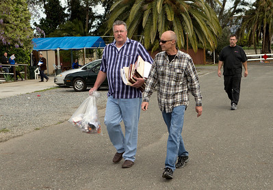 Men, who declined to be identified, carry what appears to be a bag of prescription drug containers and files, away from Life Choices, a residential drug rehabilitation facility in San Jose, Calif., on Wednesday, Mar. 5, 2014.   (LiPo Ching/Bay Area News Group)