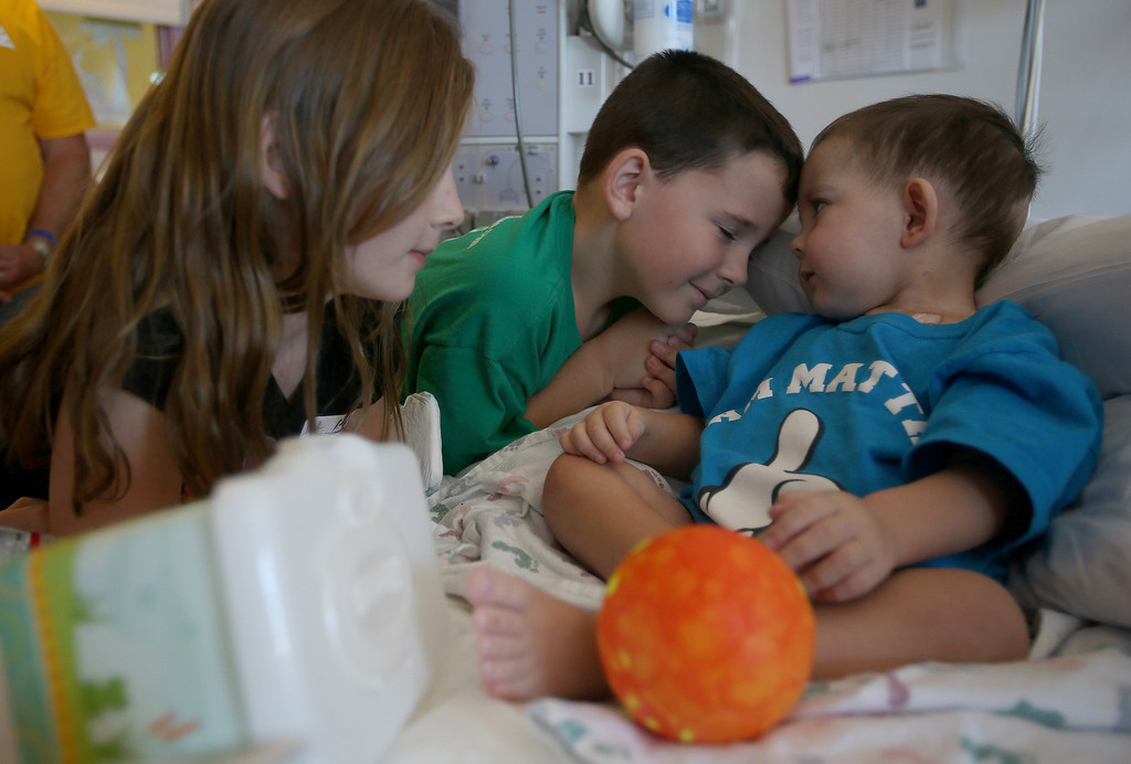 . Patrick Ouimet, 8, of Antioch, center, and his sister Molly, 10, left, spend time with their brother Matthew, 2, as he\'s discharged from the UCSF Benioff Children\'s Hospital in San Francisco Calif., on Wednesday, Aug. 14, 2013. Matthew spent 73 days at UCSF after undergoing a liver/kidney transplant on June 4. (Jane Tyska/Bay Area News Group)