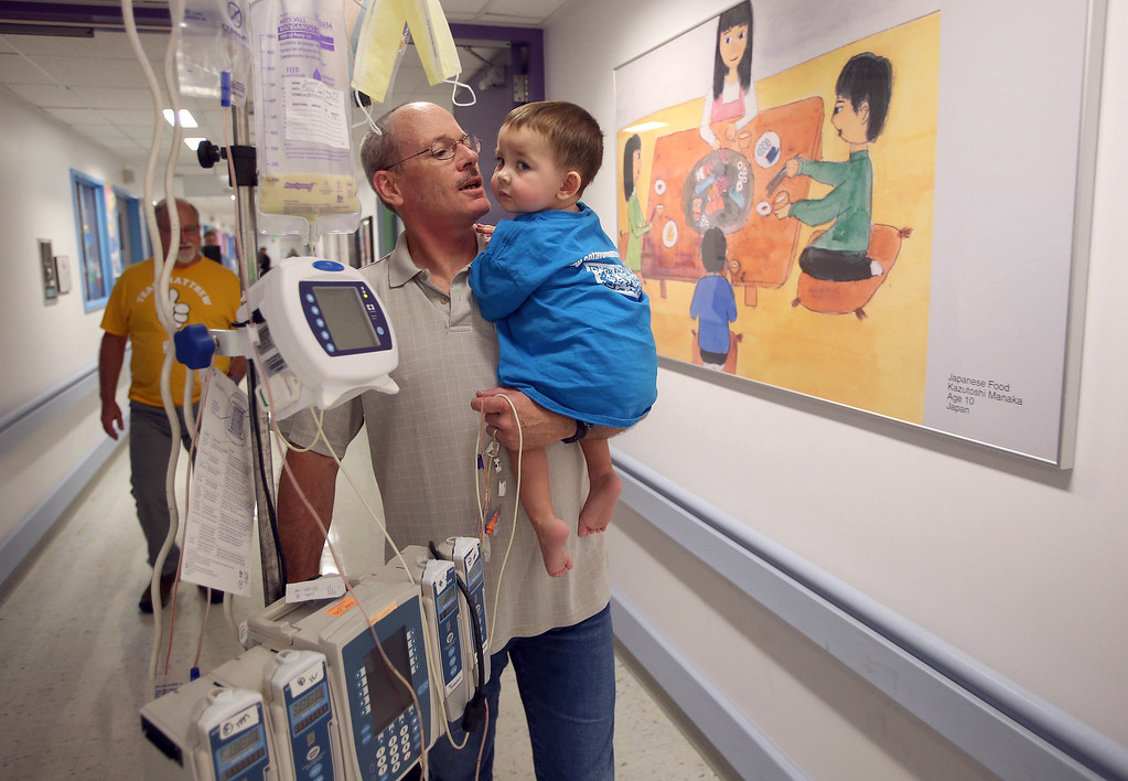 . Kelly Ouimet, of Antioch, takes his son Matthew, 2, for one last walk through the hallways as he\'s discharged from the UCSF Benioff Children\'s Hospital in San Francisco Calif., on Wednesday, Aug. 14, 2013. Matthew spent 73 days at UCSF after undergoing a liver/kidney transplant on June 4. (Jane Tyska/Bay Area News Group)