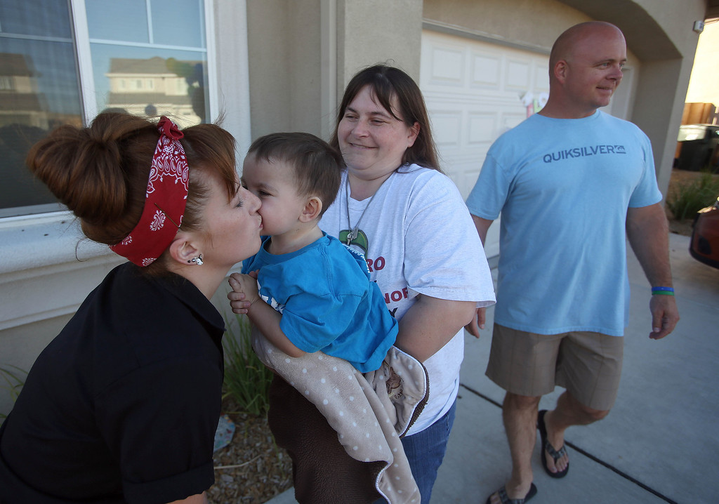 . Casey Wisecarver, of Brentwood, welcomes home her nephew Matthew Ouimet, 2, and Matthew\'s mom Kristi Ouimet, right. at the Ouimet\'s home in Antioch after he was discharged from the UCSF Benioff Children\'s Hospital in San Francisco Calif., on Wednesday, Aug. 14, 2013. To the right is Matthew\'s uncle Jimmy Wisecarver, of Brentwood. Matthew spent 73 days at UCSF after undergoing a liver/kidney transplant on June 4. (Jane Tyska/Bay Area News Group)