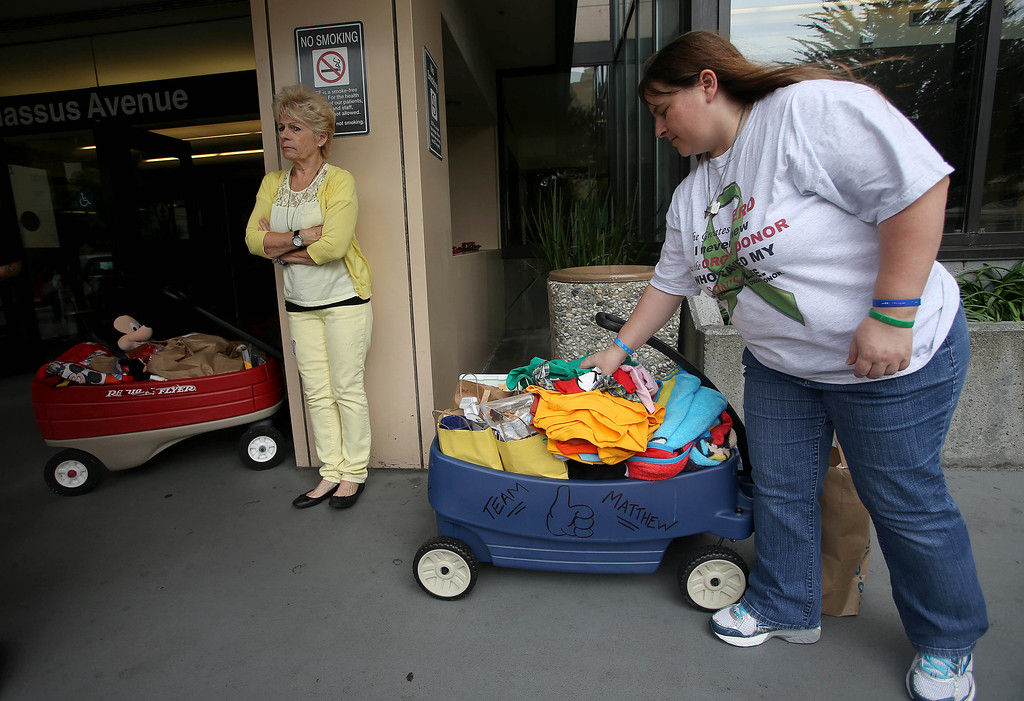 . Kristi Ouimet, of Antioch, right, packs up her son Matthew\'s belongings after he was discharged from the UCSF Benioff Children\'s Hospital in San Francisco Calif., on Wednesday, Aug. 14, 2013. To the left is her mom Joyce Wisecarver, of Antioch, Matthew, 2, spent 73 days at UCSF after undergoing a liver/kidney transplant on June 4. (Jane Tyska/Bay Area News Group)