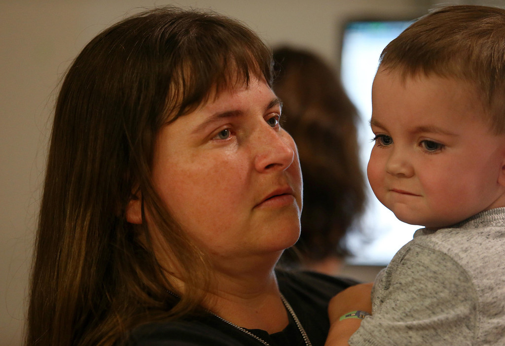 . Kristi Ouimet, of Antioch, holds her son Matthew, 2, as she\'s briefed by medical personnel before Matthew goes into the operating room for a liver and kidney transplant at the UCSF Benioff Children\'s Hospital in San Francisco, Calif., on Tuesday, June 4, 2013.  (Jane Tyska/Bay Area News Group)