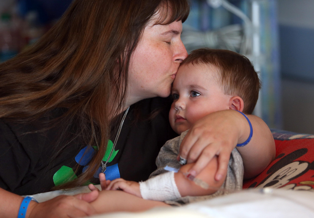 . Kristi Ouimet, of Antioch, comforts her son Matthew, 2, as he awaits a liver and kidney transplant at the UCSF Benioff Children\'s Hospital in San Francisco, Calif., on Monday, June 3, 2013. (Jane Tyska/Bay Area News Group)