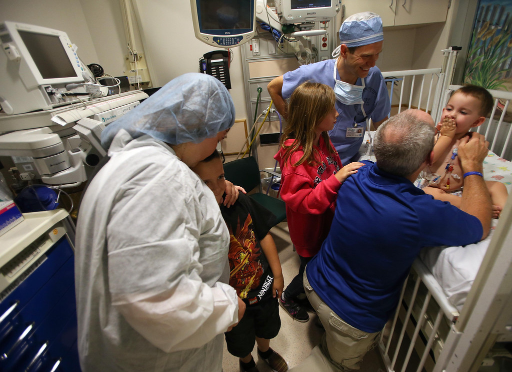 . Kristi Ouimet, of Antioch, left, with her son Patrick, 8, daughter Molly, 10, center, and husband Kelly Ouimet, right, wish their son Matthew, 2, good luck before he heads to the operating room to undergo a liver and kidney transplant at the UCSF Benioff Children\'s Hospital in San Francisco, Calif., on Tuesday, June 4, 2013. In the backround is Dr. Michael Spiro.  (Jane Tyska/Bay Area News Group)