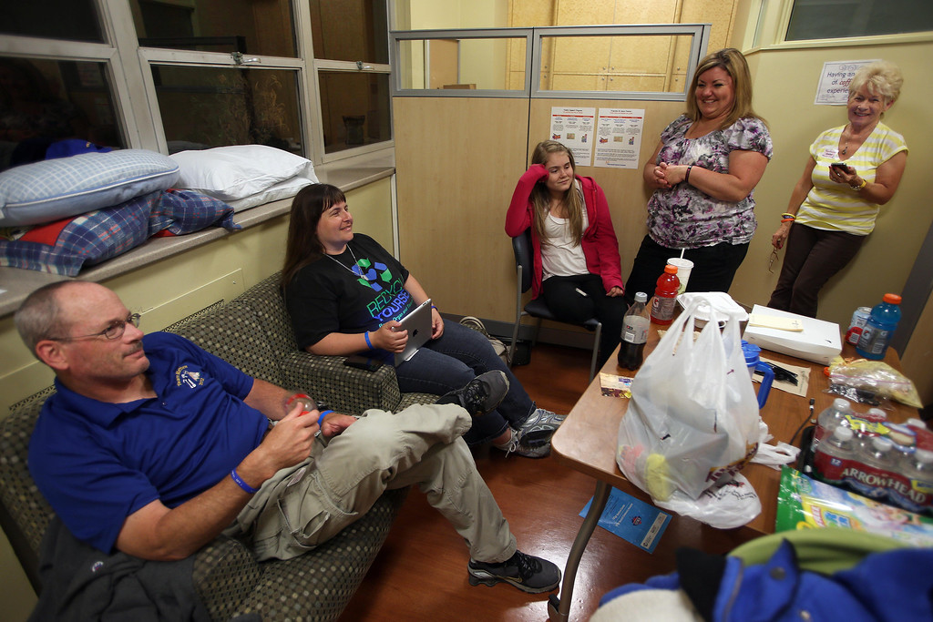 . Kelly and Kristi Ouimet, of Antioch, wait with friends Alyssa Welch, 16, of Riverbank, Calif., her mom Kim Welch, and Kristi Ouimet\'s mom Joyce Wisecarver, of Antioch, left to right, as the Ouimet\'s son Matthew, 2, undergoes a liver and kidney transplant at the UCSF Benioff Children\'s Hospital in San Francisco, Calif., on Tuesday, June 4, 2013.  (Jane Tyska/Bay Area News Group)