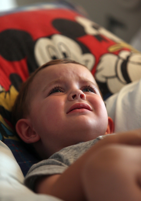 . Matthew Ouimet, 2, of Antioch, cries as he awaits a liver and kidney transplant at the UCSF Benioff Children\'s Hospital in San Francisco, Calif., on Monday, June 3, 2013. (Jane Tyska/Bay Area News Group)