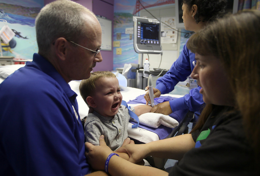 . Kristi Ouimet, right, and her husband Kelly Ouimet, of Antioch, comfort their son Matthew, 2, as receives an IV in preparation for a liver and kidney transplant at the UCSF Benioff Children\'s Hospital in San Francisco, Calif., on Monday, June 3, 2013.  (Jane Tyska/Bay Area News Group)