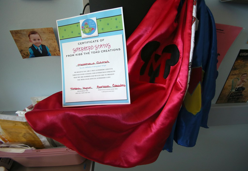 . Several capes and a super hero certificate are seen in Matthew Ouimet\'s room as he continues to recover from a liver and kidney transplant at UCSF Benioff Children\'s Hospital in San Francisco, Calif., on Wednesday, June 19, 2013.  (Jane Tyska/Bay Area News Group)