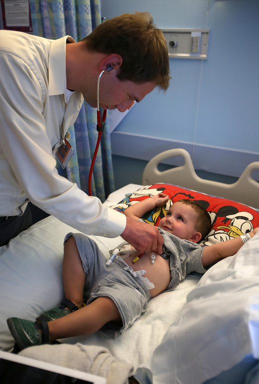 . Dr. Patrick Peebles checks on Matthew Ouimet, 2, of Antioch, as he awaits a liver and kidney transplant at the UCSF Benioff Children\'s Hospital in San Francisco, Calif., on Monday, June 3, 2013.  (Jane Tyska/Bay Area News Group)
