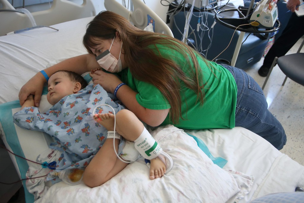 . Kristi Ouimet, of Antioch, comforts her son Matthew, 2, as he does dialysis while recovering from a liver and kidney transplant at UCSF Benioff Children\'s Hospital in San Francisco, Calif., on Wednesday, June 19, 2013. Matthew had his transplant at UCSF on June 4, and spent over a week in the pediatric intensive care unit.  (Jane Tyska/Bay Area News Group)