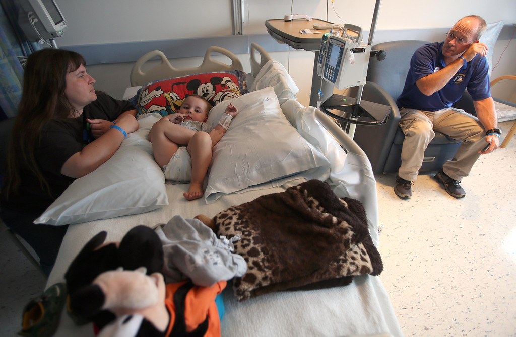 . Kristi Ouimet, left, and her husband Kelly Ouimet, of Antioch, stay with their son Matthew, 2, as he awaits a liver and kidney transplant at the UCSF Benioff Children\'s Hospital in San Francisco, Calif., on Monday, June 3, 2013. (Jane Tyska/Bay Area News Group)