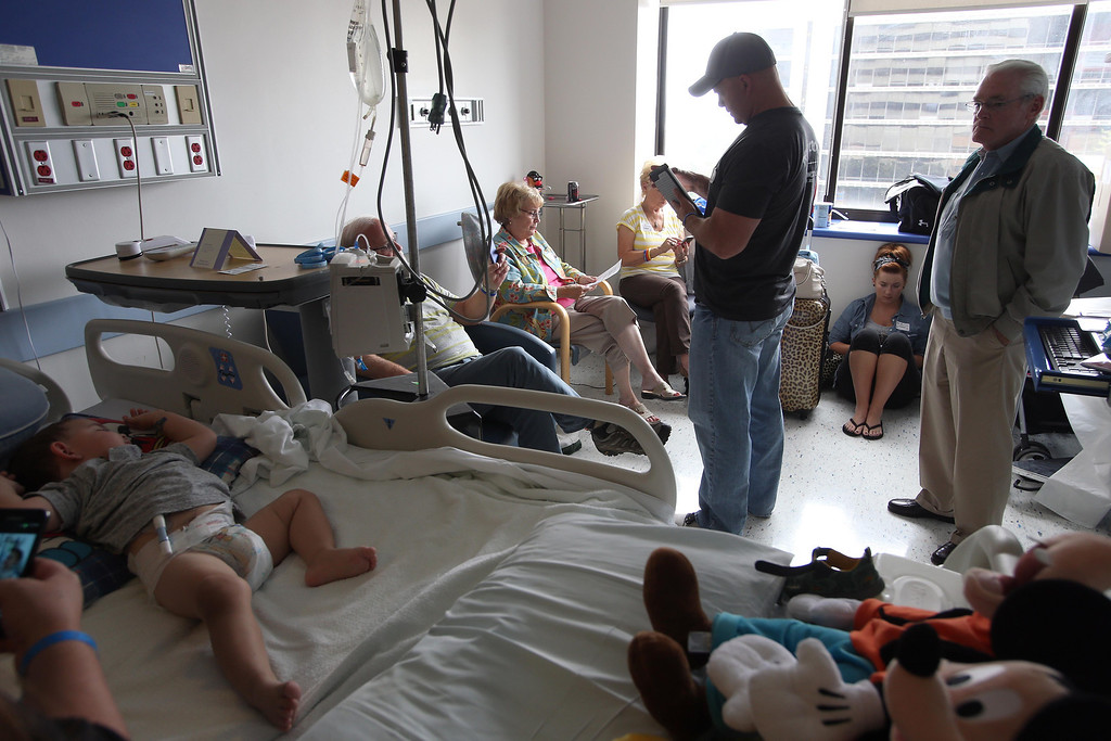 . Family members spend time with Matthew Ouimet, 2, of Antioch, left, before he heads to the operating for a liver and kidney transplant at the UCSF Benioff Children\'s Hospital in San Francisco, Calif., on Tuesday, June 4, 2013. (Jane Tyska/Bay Area News Group)