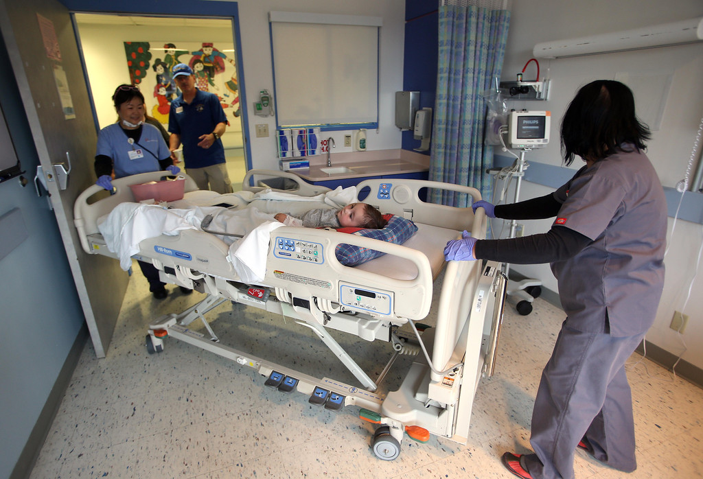. Matthew Ouimet, 2,  of Antioch, is moved to a private room as he awaits a liver and kidney transplant at the UCSF Benioff Children\'s Hospital in San Francisco, Calif., on Monday, June 3, 2013.  (Jane Tyska/Bay Area News Group)