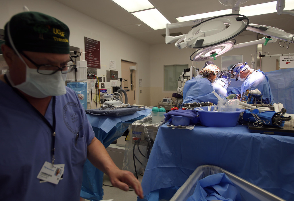 . Dr. John Roberts, right, and his surgical team operate on Matthew Ouimet, 2, of Antioch, as he undergoes a liver and kidney transplant at the UCSF Benioff Children\'s Hospital in San Francisco, Calif., on Tuesday, June 4, 2013.  (Jane Tyska/Bay Area News Group)