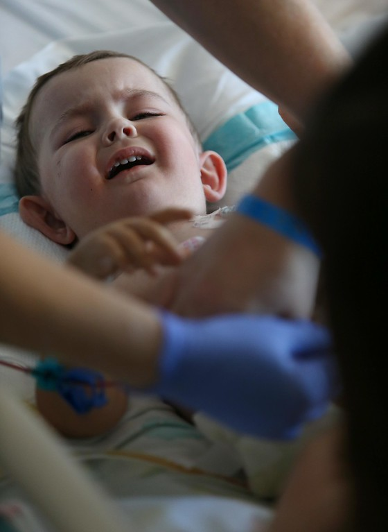 . Matthew Ouimet, 2, cries as he does dialysis while recovering from a liver and kidney transplant at UCSF Benioff Children\'s Hospital in San Francisco, Calif., on Wednesday, June 19, 2013.  (Jane Tyska/Bay Area News Group)