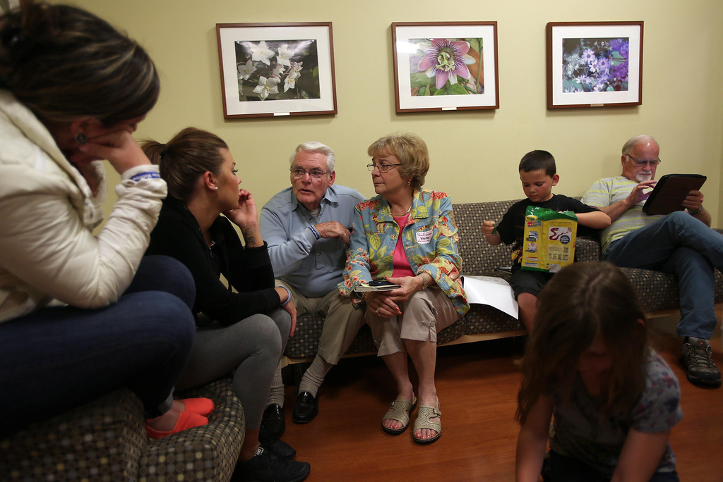 . Matthew Ouimet\'s sisters Jordan Pfalzer, Brittany Ouimet, his grandparents Don and Bea Ouimet, brother Patrick 8, sister Molly, 10, foreground and grandfather Jim Wisecarver, left to right, wait as Matthew, 2, undergoes a liver and kidney transplant at the UCSF Benioff Children\'s Hospital in San Francisco, Calif., on Tuesday, June 4, 2013. (Jane Tyska/Bay Area News Group)