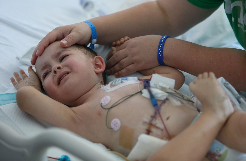 . Kristi Ouimet, of Antioch, comforts her son Matthew, 2, as he continues to recover from a liver and kidney transplant at UCSF Benioff Children\'s Hospital in San Francisco, Calif., on Wednesday, June 19, 2013.  (Jane Tyska/Bay Area News Group)