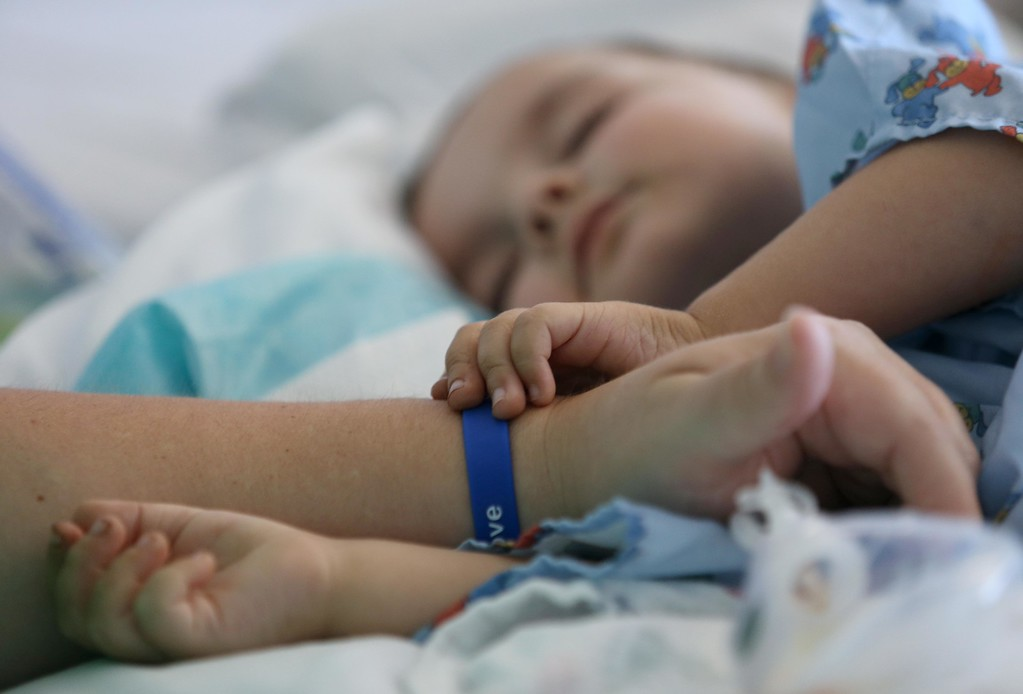 . Kristi Ouimet, of Antioch, left, comforts her son Matthew, 2, as he continues to recover from a liver and kidney transplant at UCSF Benioff Children\'s Hospital in San Francisco, Calif., on Wednesday, June 19, 2013.  (Jane Tyska/Bay Area News Group)