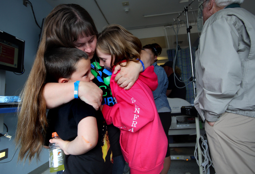 . Kristi Ouimet, of Antioch, comforts her children Molly, 10, right, and Patrick, 7, as her son Matthew, 2, awaits a liver and kidney transplant at the UCSF Benioff Children\'s Hospital in San Francisco, Calif., on Tuesday, June 4, 2013.  (Jane Tyska/Bay Area News Group)