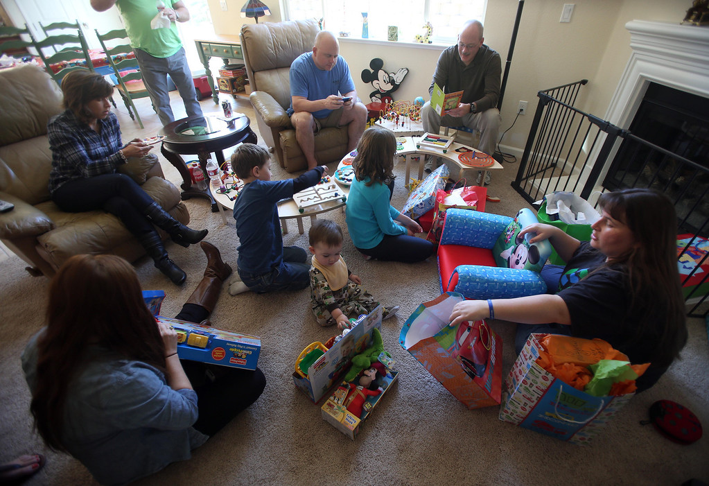 . Kristi Ouimet, right, and her son Matthew, 2, center, open presents as they celebrate his birthday with family and friends at their home in Antioch, Calif., on Sunday, Feb. 10, 2013. Matthew, who suffers from primary hyperoxaluria type 1, a rare liver disease, turned two on Feb. 11. He undergoes dialysis six times a week at the UCSF Medical Center in San Francisco, and is on the transplant list awaiting a liver and kidneys. (Jane Tyska/Staff)