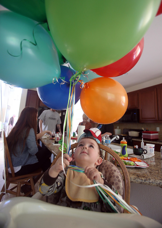 . Matthew Ouimet, 2, plays with balloons as he celebrates his birthday with family and friends at his home in Antioch, Calif., on Sunday, Feb. 10, 2013. Matthew, who suffers from primary hyperoxaluria type 1, a rare liver disease, turned two on Feb. 11. He undergoes dialysis six times a week at the UCSF Medical Center in San Francisco, and is on the transplant list awaiting a liver and kidneys. (Jane Tyska/Staff)