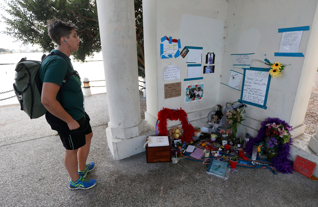 ". Claire Davis, of Oakland, pays respects at a memorial for ""Willie\"" at Lake Merritt in Oakland, Calif., on Monday, Aug. 29, 2016. (Jane Tyska/Bay Area News Group)"