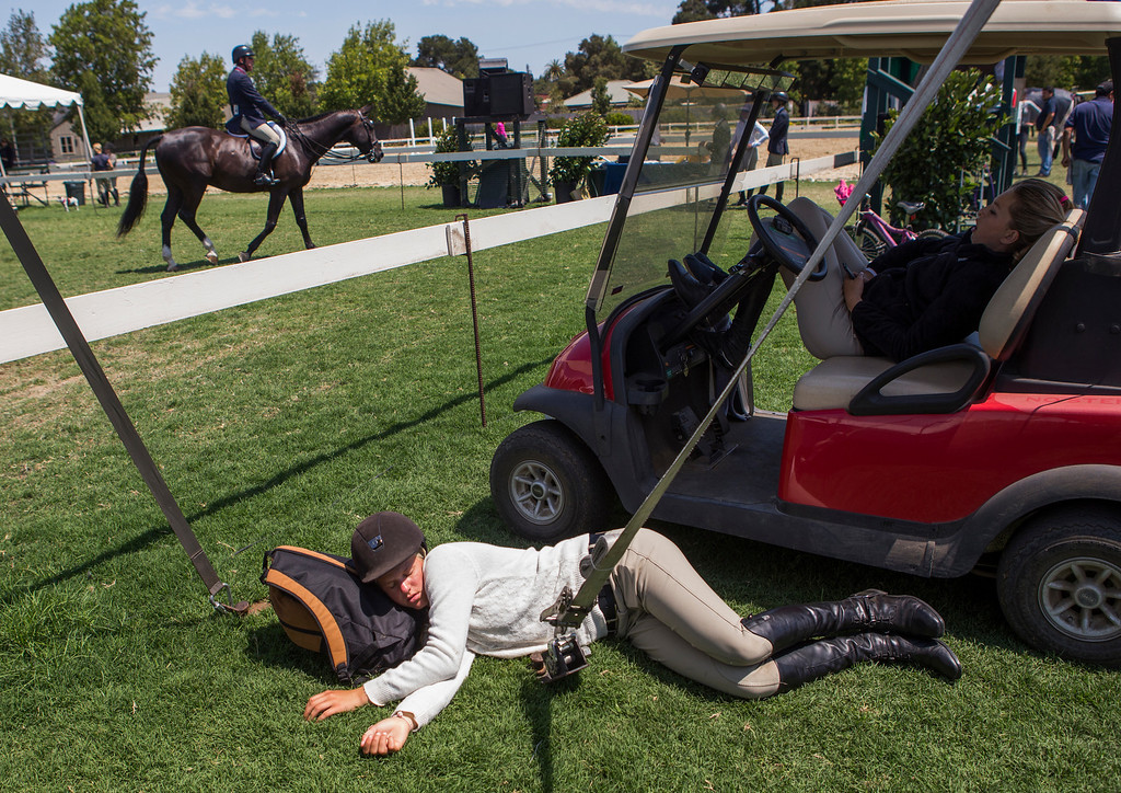 . Abby Jorgenson, 17, catches some sleep during a break from her performace in the jumpers at the 43 annual Menlo Charity Horse Show at the Menlo Circus Club in Atherton, Calif., on Tuesday, Aug. 6, 2013. The show benefits Vista Center for the Blind and Visually Impaired, and runs  August 6-11. (John Green/Bay Area News Group)