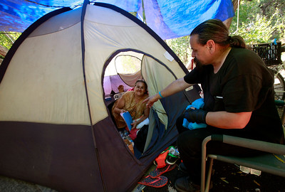 Homeless advocate Robert Aguirre (right) talks with Amanda Fukamoto about the Stream Steward project she helps run for the homeless people living along Coyote Creek in San Jose, Calif., Thursday afternoon, June 30, 2016. (Karl Mondon/Bay Area News Group)