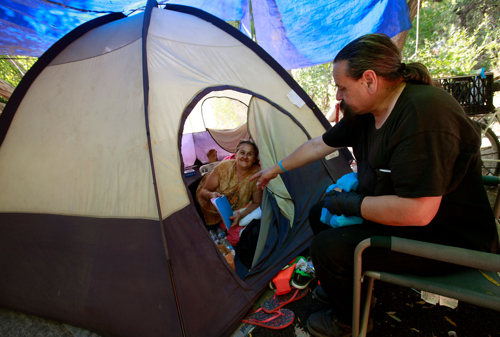 . Homeless advocate Robert Aguirre (right) talks with Amanda Fukamoto about the Stream Steward project she helps run for the homeless people living along Coyote Creek in San Jose, Calif., Thursday afternoon, June 30, 2016. (Karl Mondon/Bay Area News Group)
