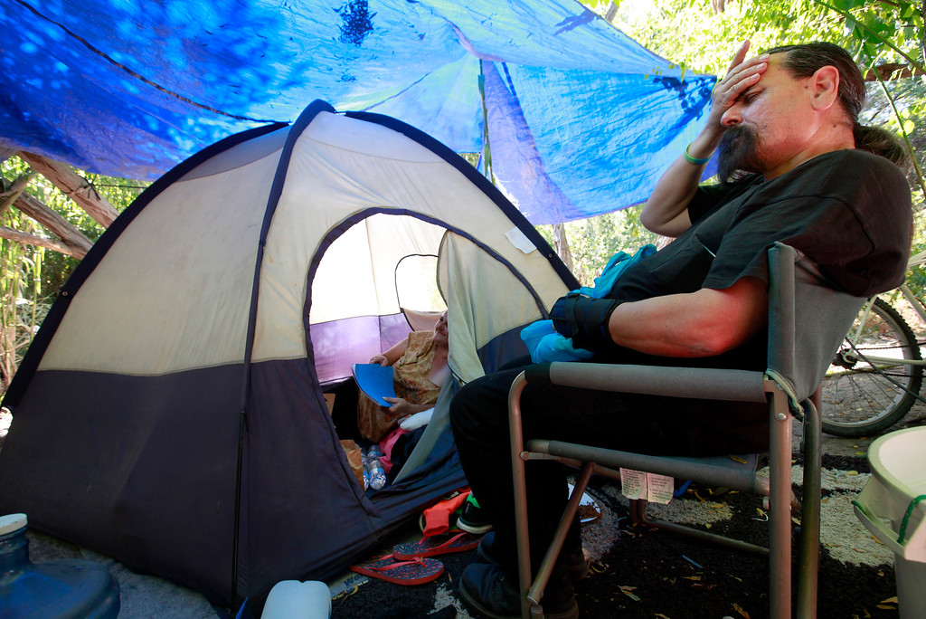 . Homeless advocate Robert Aguirre (right) talks with Amanda Fukamoto living along Coyote Creek in San Jose, Calif., Thursday afternoon, June 30, 2016. (Karl Mondon/Bay Area News Group)