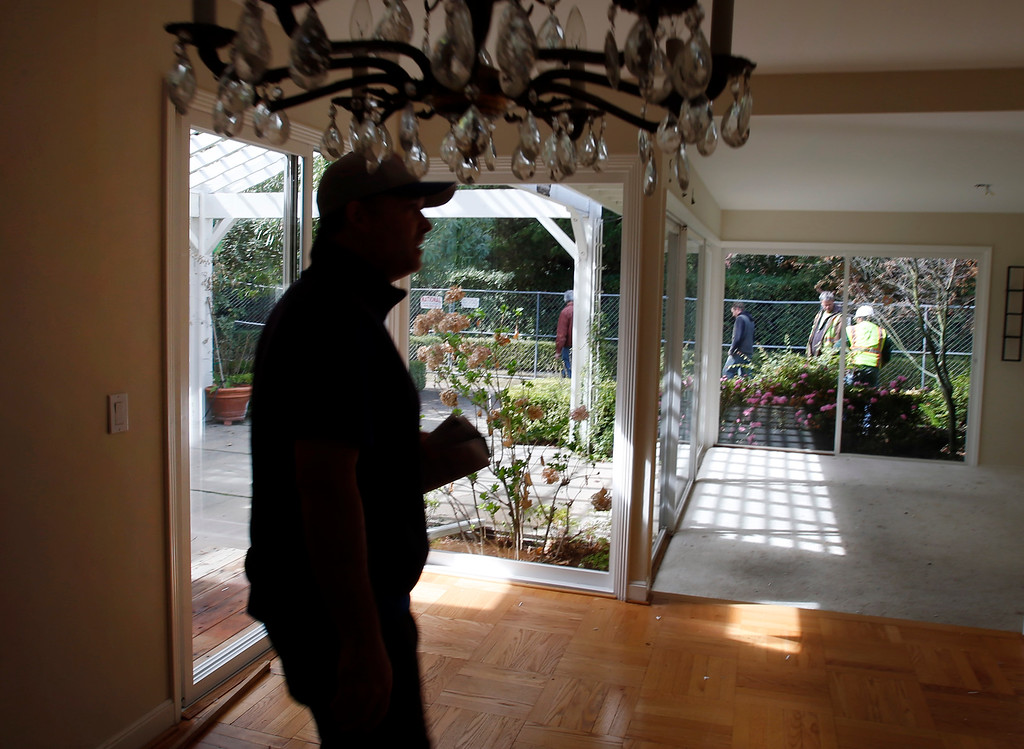 . James Bergeron walks through his home in Menlo Park, Calif., one last time as wreckers prepare to demolish it Thursday afternoon, Feb. 27, 2014. It was more cost-effective to rebuild a new house on that lot than to remodel that 67-year-old slab foundation structure. (Karl Mondon/Bay Area News Group)