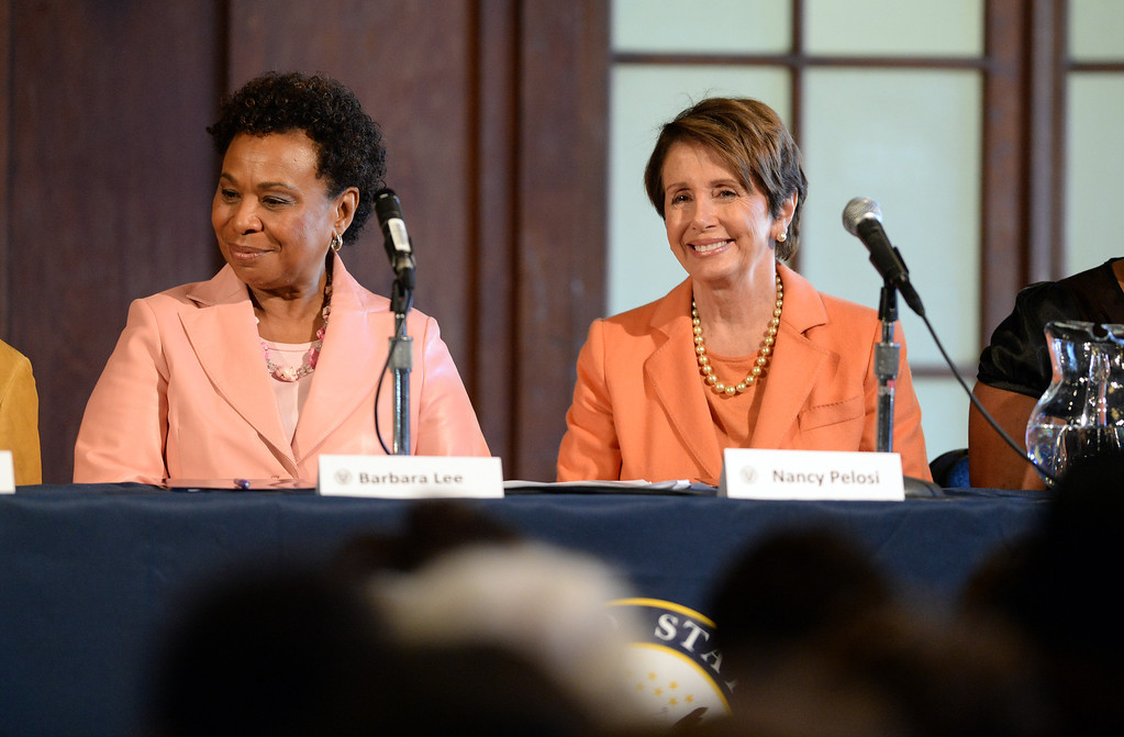 . Congresswomen Barbara Lee, left, and Nancy Pelosi, right participate in a forum on women\'s economic empowerment and unveiling of a commemorative stamp honoring Shirley Chisholm held at Mills College in Oakland, Calif., on Saturday, Feb. 1, 2014. The forum and unveiling featured Mills alum Congresswoman Barbara Lee and Congresswoman Nancy Pelosi, among others. Shirley Chisholm was the first African American elected to Congress. (Dan Honda/Bay Area News Group)