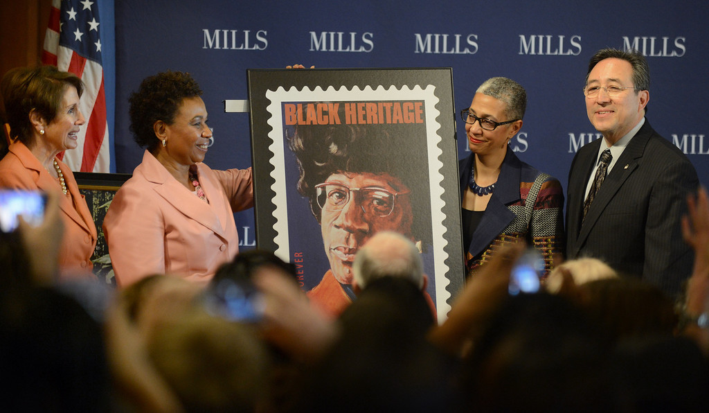 . Congresswoman Nancy Pelosi, far left, Congresswoman Barbara Lee, Mills College president Alecia A. DeCoudreaux, and Daryl Trujillo, Oakland Postmaster, far right, unveil the new Shirley Chisholm stamp at a forum on women\'s economic empowerment and unveiling of a commemorative stamp honoring Shirley Chisholm held at Mills College in Oakland, Calif., on Saturday, Feb. 1, 2014. The forum and unveiling featured Mills alum Congresswoman Barbara Lee and Congresswoman Nancy Pelosi, among others. Shirley Chisholm was the first African American elected to Congress. (Dan Honda/Bay Area News Group)